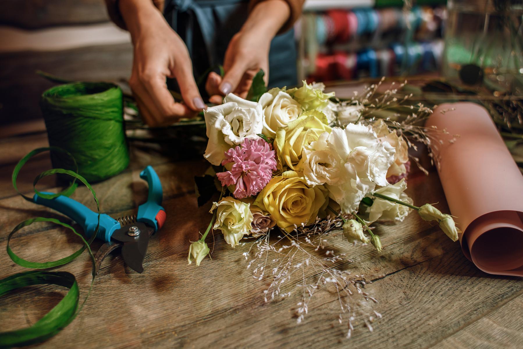 Small business florist arranging a bouquet